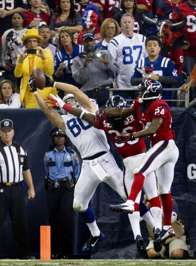 Colts tight end Coby Fleener pulls down a 2-point conversion with Texans strong safety D.J. Swearinger and cornerback Johnathan Joseph defending. Photo: Cody Duty, Houston Chronicle