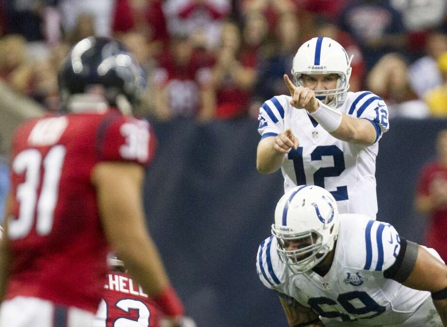 Colts quarterback Andrew Luck directs his team at the line of scrimmage. Photo: Cody Duty, Houston Chronicle