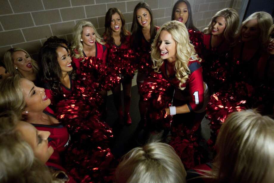 Texans cheerleaders huddle before taking the field to perform prior to a game. Photo: Houston Chronicle
