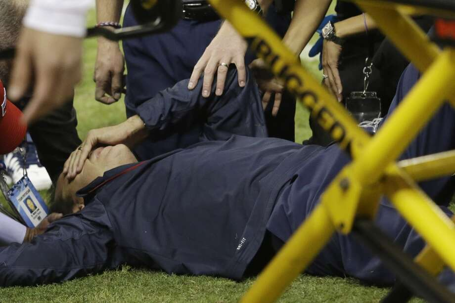 Houston Texans head coach Gary Kubiak gets medical attention after he collapsed while leaving the field at the end of the first half of an NFL football game against the Indianapolis Colts, Sunday, Nov. 3, 2013, in Houston. (AP Photo/Patric Schneider) Photo: Associated Press