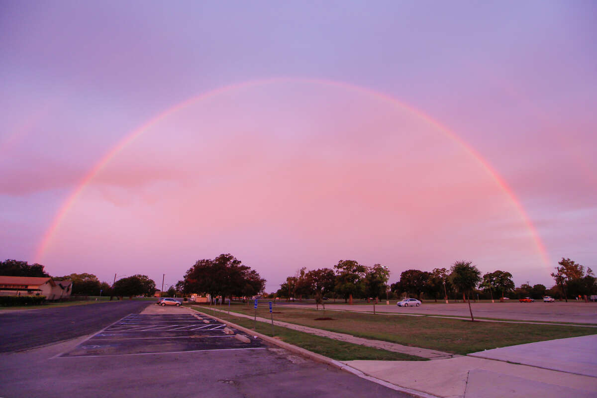 An early morning rainbow as seen from the Harlandale Memorial Stadium parking lot looking west across Roosevelt Avenue on Monday, Nov. 4, 2013.