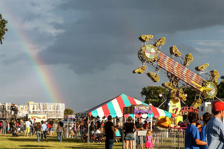 A rainbow was visible in the distance at the Carnival at the Annual  Kendall County Fair, Stock Show and Rodeo at the Kendall County Fairgrounds on Sept. 1, 2012.  Photo: MARVIN PFEIFFER, Marvin Pfeiffer / Prime Time New / Prime Time Newspapers 2012