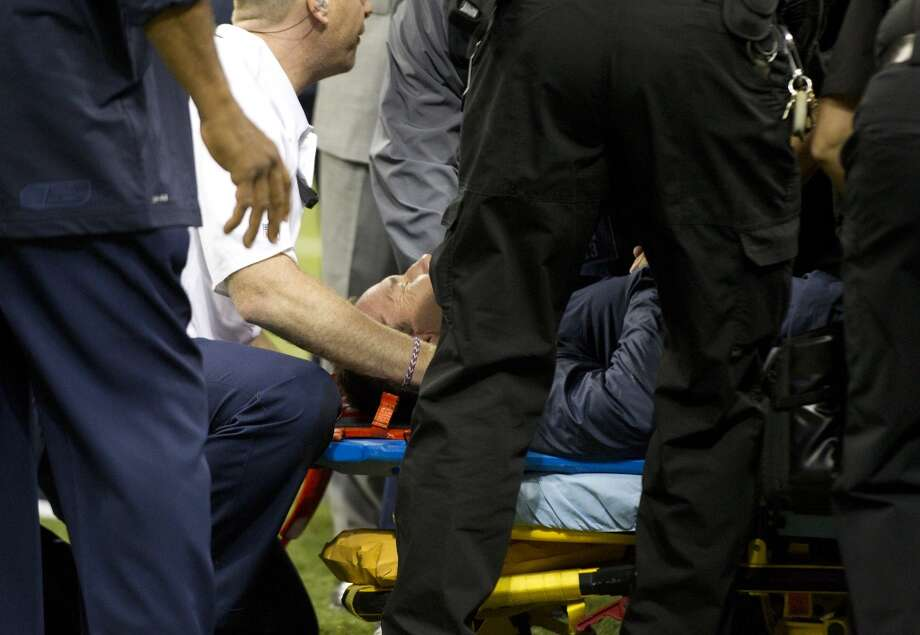 Medical personel attend to Houston Texans head coach Gary Kubiak after he collapsed on the field at the end of the first half against the Indianapolis Colts  at Reliant Stadium on Sunday, Nov. 3, 2013, in Houston. ( Brett Coomer / Houston Chronicle ) Photo: Houston Chronicle