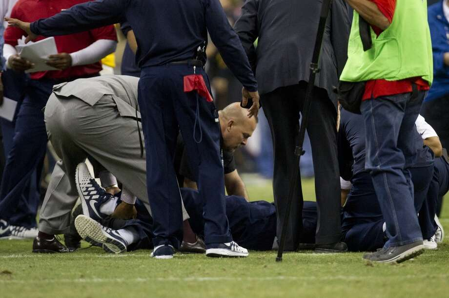 Medical personal attend to Houston Texans head coach Gary Kubiak after he collapsed as the end of the first half of an NFL football game at Reliant Stadium, Sunday, Nov. 3, 2013, in Houston. (Cody Duty / Houston Chronicle) Photo: Houston Chronicle