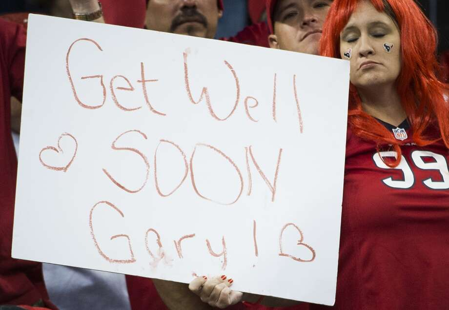 A Houston Texans fan holds a sign in support of head coach Gary Kubiak during the fourth quarter of an NFL football game on Sunday, Nov. 3, 2013, at Reliant Stadium in Houston. Kubiak collapsed on the field at halftime and was taken to the hospital. ( Smiley N. Pool / Houston Chronicle ) Photo: Houston Chronicle