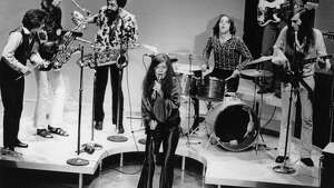Rock-folk singer Janis Joplin performs with her group in Dec. 1969 at an unknown location.  (AP Photo)