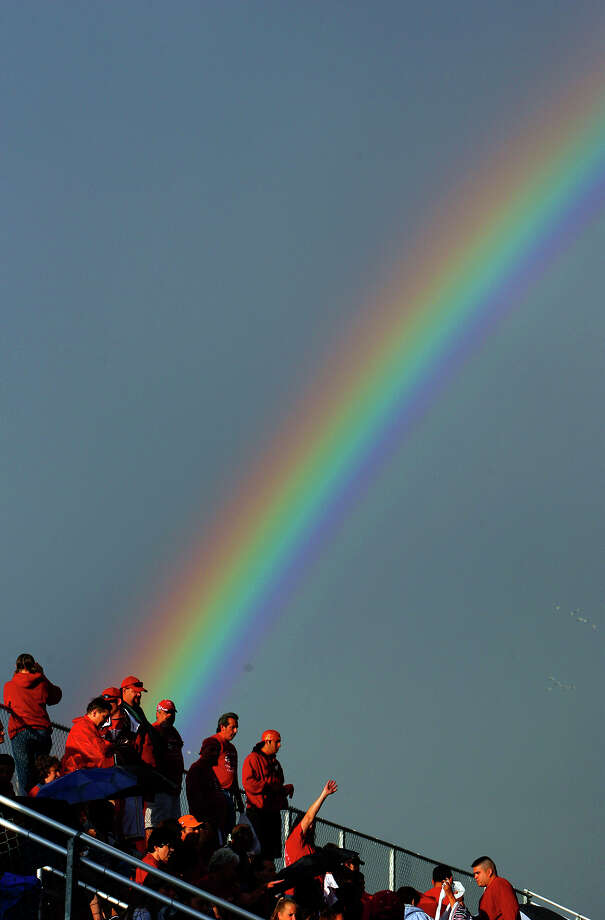 A rainbow is pictured behind Taft high school softball fans prior to the game against Smithson Valley Thursday May 10, 2007. Photo: EDWARD A. ORNELAS, SAN ANTONIO EXPRESS-NEWS / SAN ANTONIO EXPRESS-NEWS