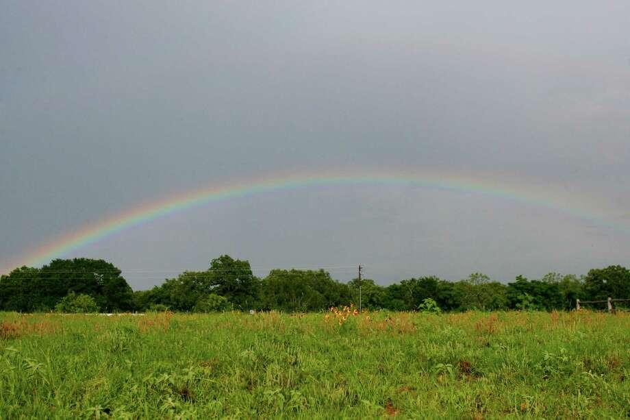 A rainbow appears near Fredericksburg, Texas, recently after showers passed through the area.  Photo: EDWARD A. ORNELAS, SAN ANTONIO EXPRESS-NEWS / SAN ANTONIO EXPRESS-NEWS