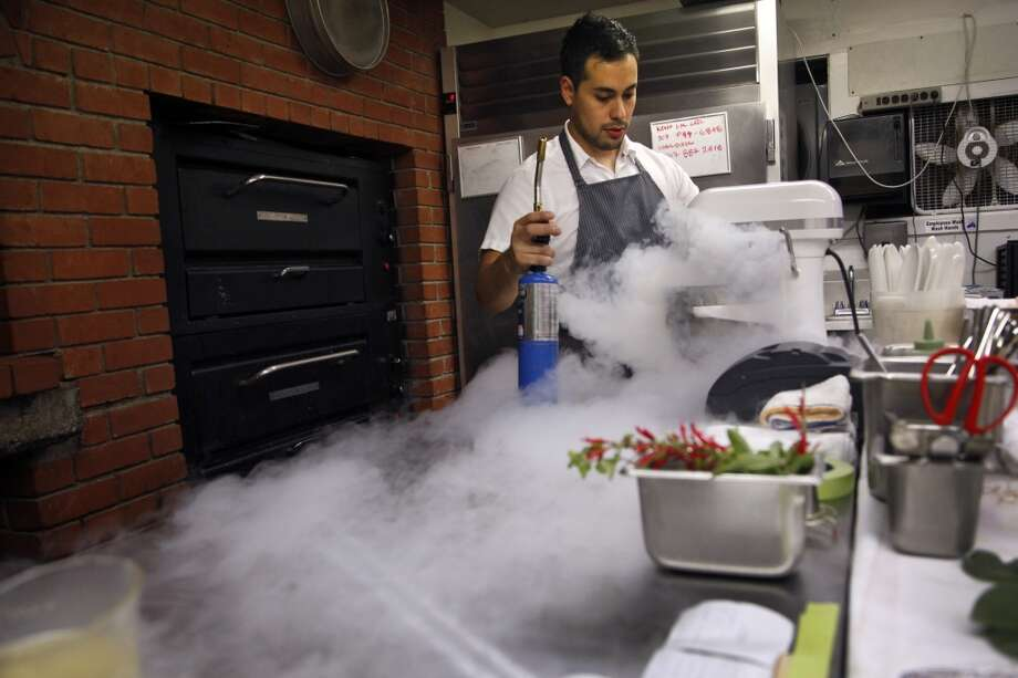 Pastry chef Emmanuel Fimbrez makes ice cream with liquid nitrogen. Photo: Preston Gannaway, Special To The Chronicle