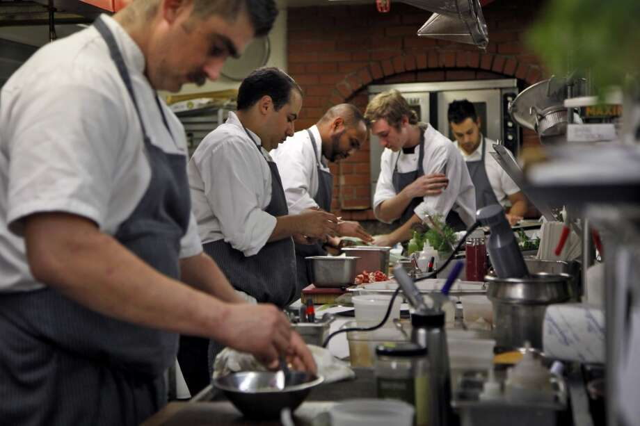 Cooks fill the kitchen at Madrona Manor Restaurant in Healdsburg. Photo: Preston Gannaway, Special To The Chronicle