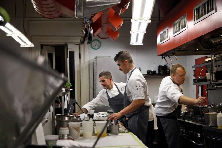 Executive chef Jesse Mallgren (left) works in the kitchen with sous chef Calvin Moran (center) and entremetier Kyle Kemp (right) at Madrona Manor . Photo: Preston Gannaway, Special To The Chronicle