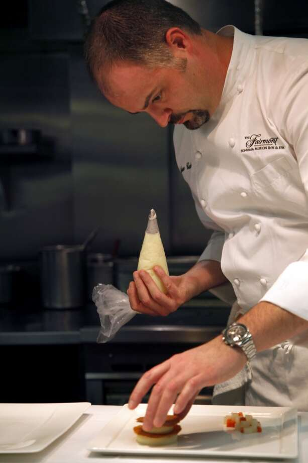 Chef Andrew Cain plates a dish at Fairmont Sonoma Mission Inn's Sante. Photo: Preston Gannaway, Special To The Chronicle