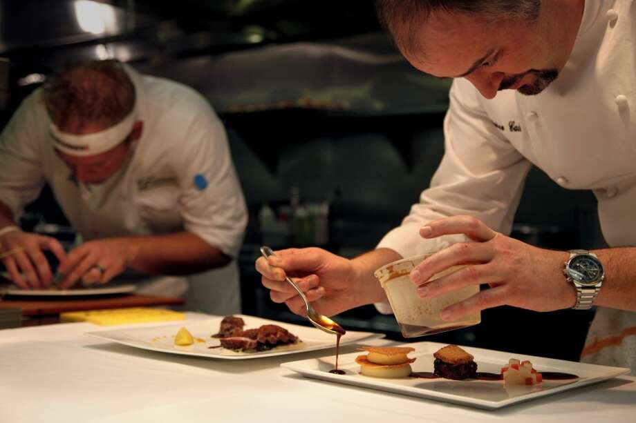Chef Andrew Cain plates a dish. Photo: Preston Gannaway, Special To The Chronicle