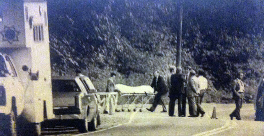 Investigators remove the body of a young woman who apparently was killed within the prior few days and was found yards from the Green River. An elderly couple found the body. Photo filed Sept. 20, 1984. (Copyright MOHAI, Seattle Post-Intelligencer Collection, 2000.107) Photo: MOHAI Archive