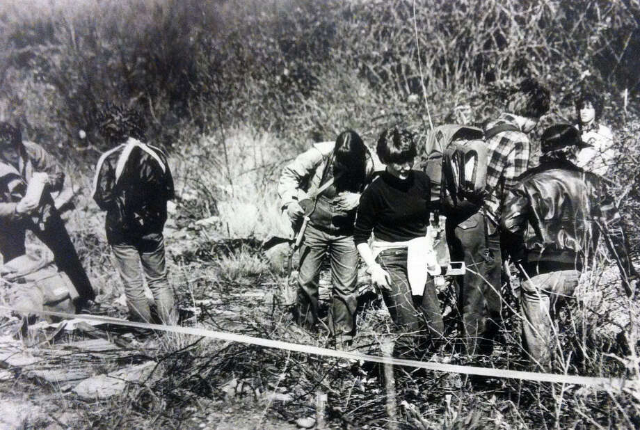 Explorers search for bones near South 146th Street and 16th Avenue South. Photo filed April 4, 1984. (Photo by Phil Webber, copyright MOHAI, Seattle Post-Intelligencer Collection, 2000.107) Photo: MOHAI Archive