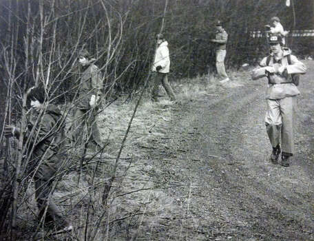 Explorer scout David Ashby, on right, gives the command to start a thorough search of the area just south of Interstate 90 near North Bend. Phoeo filed April 4, 1984. (Photo by Jeff Larsen, copyright MOHAI, Seattle Post-Intelligencer Collection, 2000.107) Photo: MOHAI Archive