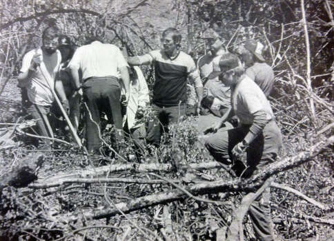 Washington County, Ore., deputy sheriffs and explorer scouts search a heavily wooded area on June 20, 1985, for clues that may link the deaths of two women to Seattle's Green River killer. Numerous bones were found at the site and were expected to be linked to an unidentified teenage girl. Another set of bones found last week were identified as the remains of Denise Darcel Bush, 23, who disappeared near Sea-Tac International Airport in October 1982. (Copyright MOHAI, Seattle Post-Intelligencer Collection, 2000.107) Photo: MOHAI Archive
