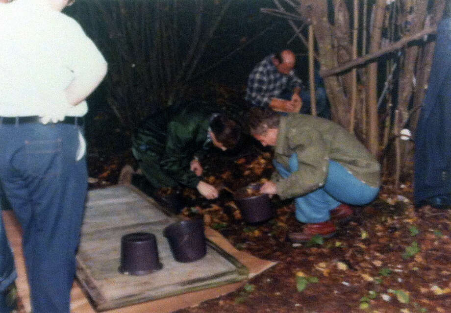 Detectives Dave Reichert (center, green jacket) and Pat Ferguson gather evidence from sites where bodies were found south of Seattle-Tacoma International Airport in the fall of 1983.(King County Sheriff's Office photo, copyright MOHAI, Seattle Post-Intelligencer Collection, 2000.107) Photo: MOHAI Archive