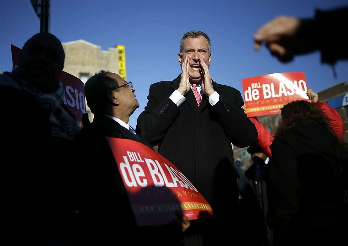 Democratic New York City mayoral candidate Bill de Blasio campaigns at a subway stop in New York, Monday, Nov. 4, 2013. The mayoral election will take place on Tuesday, Nov. 5, 2013. (AP Photo/Seth Wenig)