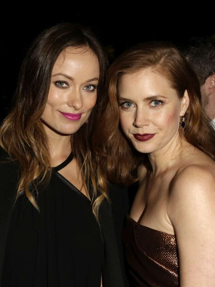 Actors Olivia Wilde and Amy Adams attend the LACMA 2013 Art + Film Gala honoring Martin Scorsese and David Hockney presented by Gucci at LACMA on November 2, 2013 in Los Angeles, California. Photo: Jeff Vespa, Getty Images For LACMA