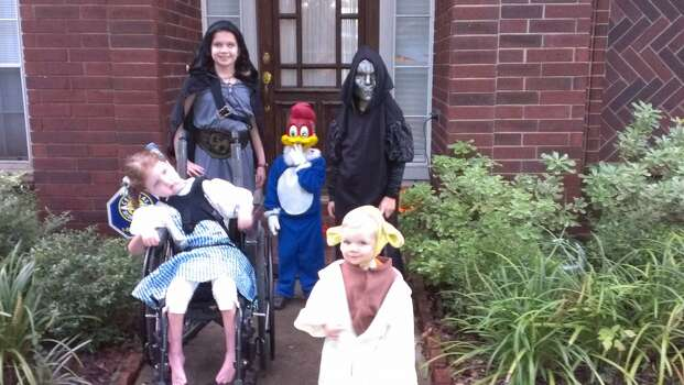 These are my 5 kiddos just before we left to go trick or treating. My oldest, Emily (10) was a huntress, next Dallin (8) was a Death Eater from Harry Potter, My daughter, Kylie (6) who is in a wheel chair dressed as Dorothy from the Wizard of Oz and she loved to watch the reflection of the sparkles on the dress. Next, due to Netflix, my 3 year old, Devin is obsessed with Woody Woodpecker and we had to scavenge the internet to find a mask, and last my cute little 15-month old, Camden was Yoda from Star Wars. I have a super fun active crazy crew!!