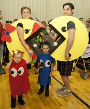 Our family costume featuring Mr and Ms Pac-Man accompanied by the adorable ghosts Blinky and Inky.