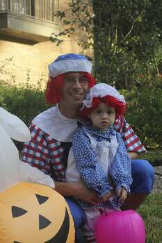 My husband, Reagan, and my daughter, Charlotte are in this photo. She requested to be Raggedy Annie and wanted my husband to be Raggedy Andy because she has an old book of his with these characters. I love that she didn't want to be a princess or a tv character quite yet-she is 2 and a total chatterbox but this was just a classic moment! thanks for the consideration! 