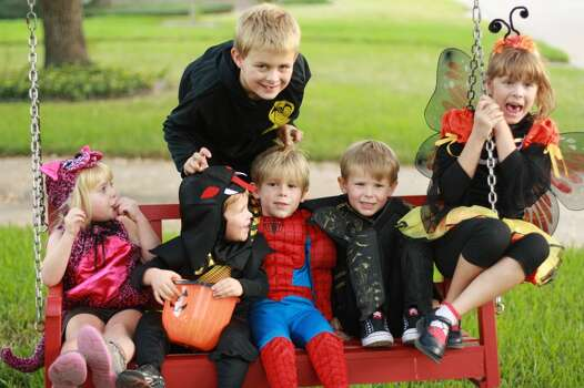 Gathering on the swing, getting ready for trick or treating with friends in the neighborhood. Our daughter is the bumblebee.