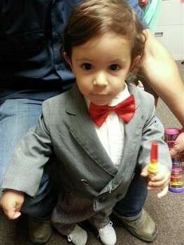 In the photo is my 2 year old grandson Apollo Lira He's costume is Pee Wee Hermann. 