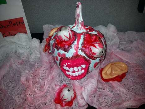 This is Zedd the Undead Zombie Pumpkin! He's a messy eater...leaving trails of body parts as he goes!