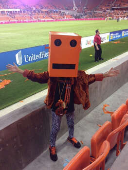 This is my 11 year old son, Christian dressed as Shuffle Bot from the dance group LMFAO. We went to the Houston Dynamo game so we decided to do a Shuffle Bot-Dynamo edition. DYNOBOT Christian said he will now where this to every Dynamo game we go to. Gooo Dynamo!!