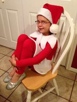 "Natalie Kolb, age7, as ""Elf on a Shelf.""