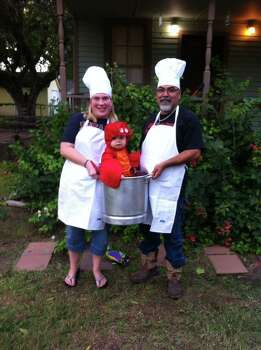 Stacie Broman and JR Torres holding our little lobster Justin Torres. Halloween 2013.
