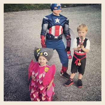 My kiddos... Oldest Patrick as Captain America, Middle Enrique as Jake the Pirate, Youngest Yvonne as a sweet little Owl. My Mother-n-law made the owl costume!