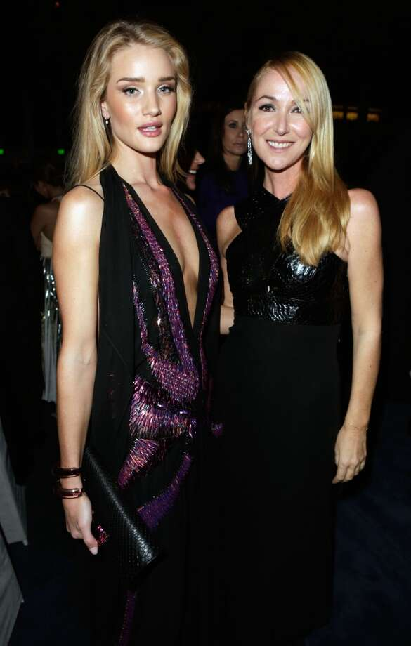 Actress Rosie Huntington-Whiteley, wearing Gucci, and Creative Director of Gucci Frida Giannini attend the LACMA 2013 Art + Film Gala honoring Martin Scorsese and David Hockney presented by Gucci at LACMA on November 2, 2013 in Los Angeles, California. Photo: Jeff Vespa, Getty Images For LACMA