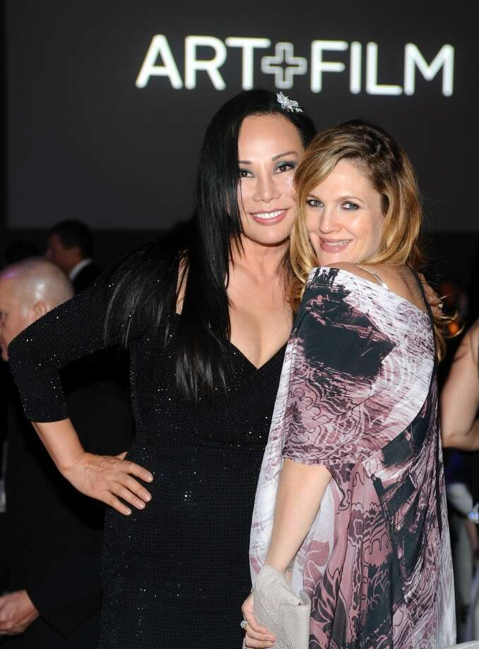 (L-R) Art+Film Gala Co-Chair Eva Chow, wearing Gucci, and actress Drew Barrymore attend the LACMA 2013 Art + Film Gala honoring Martin Scorsese and David Hockney presented by Gucci at LACMA on November 2, 2013 in Los Angeles, California. Photo: Stefanie Keenan, Getty Images For LACMA