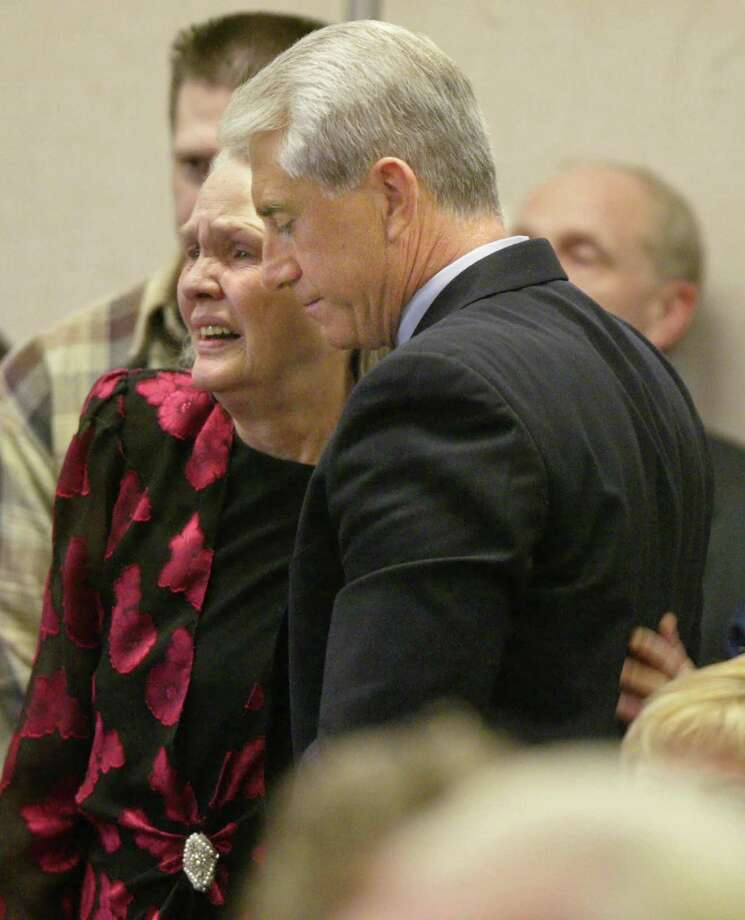 Joan Mackie mother of Green River Killer victim Cindy Smith gets a hug from King County Sheriff Dave Reichert at the sentencing of Gary Ridgway in King County Washington Superior Court December 18, 2003 in Seattle, Washington. Ridgway received 48 life sentences, with out the possibility of parole, for killing 48 women over the past 20 years in the Green River Killer serial murder case. Photo: Pool, / / 2003 Getty Images