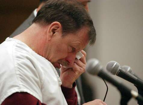 Green River Killer Gary Ridgway cries in a King County Superior Court Dec. 18, 2003 in Seattle. Ridgway received 48 life sentences, with out the possibility of parole, for killing 48 women over the past 20 years in the Green River Killer serial murder case. Photo: Pool, / / 2003 Getty Images