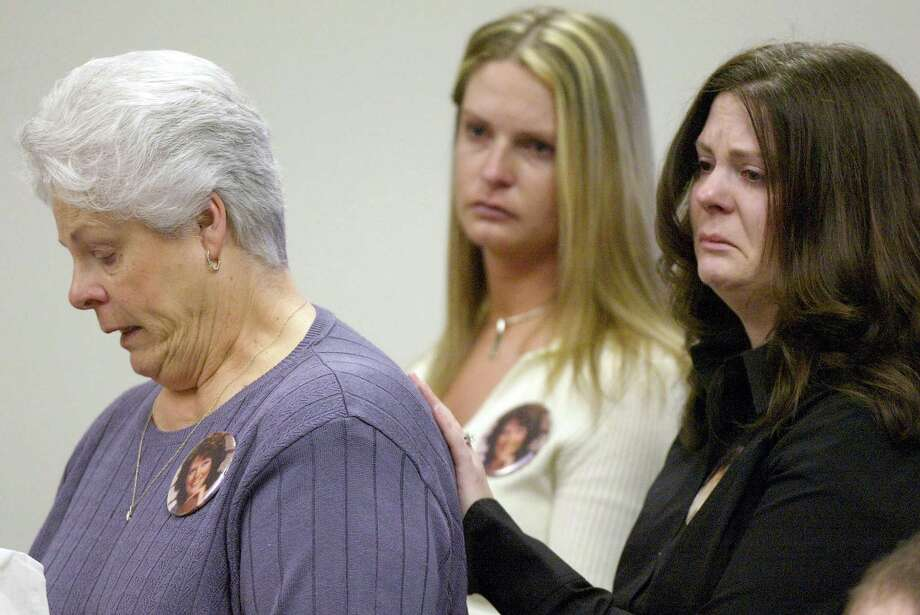 Rosemary Fries (L) mother of Green River Killer victim Shirley Sherrill speaks at the sentencing of Gary Ridgway as her daughters Deanna Brewer (C) and Michele Andrews listen in King County Washington Superior Court December18, 2003 in Seattle, Washington. Ridgway recieved 48 life sentences, without the possibility of parole, for killing 48 women over the past 20 years in the Green River Killer serial murder case. Photo: Pool, / / 2003 Getty Images