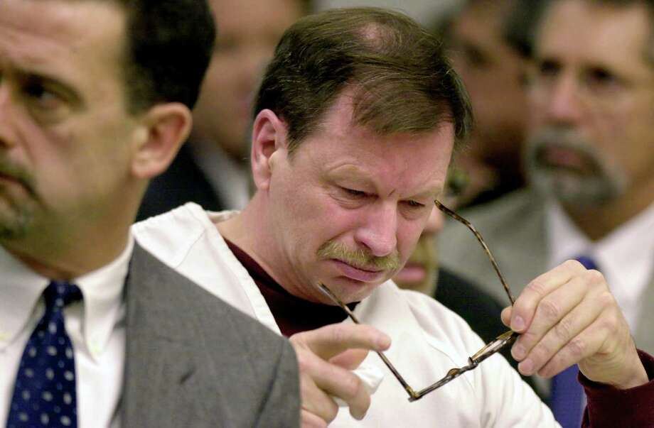 Gary Ridgway breaks down as he listens to Robert Rule, the father of victim Linda Rule during the sentencing in King County Washington Superior Court December 18, 2003 in Seattle.  Ridgway recieved 48 life sentences, with out the possibility of parole, for killing 48 women over the past 20 years in the Green River Killer serial murder case. Photo: Pool, / / 2003 Getty Images