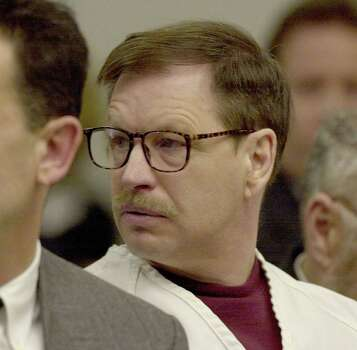 Gary Ridgway listens to a victim's family member address the court during the sentencing portion of his trial Dec. 18, 2003 in Seattle, Washington. Ridgway recieved a life sentence, with out the possibility of parole, for killing 48 women over the past 20 years in the Green River Killer serial murder case. Photo: Pool, / / 2003 Getty Images