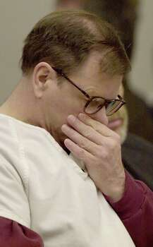 Gary Ridgway listens to a victim's family member address the court during the sentencing portion of his trial Dec. 18, 2003 in Seattle. Ridgway received a life sentence, with out the possibility of parole, for killing 48 women over the past 20 years in the Green River Killer serial murder case. Photo: Pool, / / 2003 Getty Images