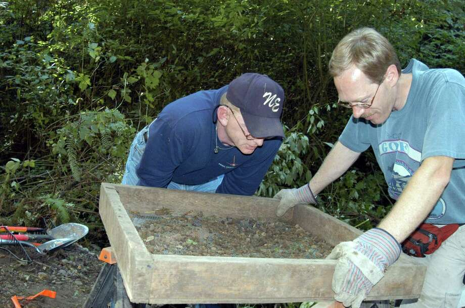 In this undated King County Prosecutor's Office  handout photo, investigators search for the remains of one of Green River killer Gary Leon Ridgway victims at a unknown location. On November 5, 2003 in Seattle, Washington, Ridgway plead guilty to 48 murders dating back more than 20 years.  (Photo by King County Prosecutor's Office via Getty Images) Photo: Getty Images, / / King County Prosecutor's Office