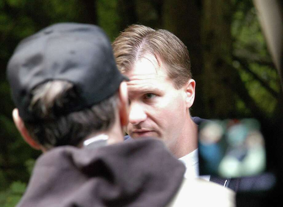 In this undated King County Prosecutor's Office handout photo, Green River killer Gary Leon Ridgway is seen as he takes investigators to one of the sights where he said he allegedly buried one of his victims. On Nov. 5, 2003, Ridgway plead guilty to 48 murders dating back more than 20 years.  (Photo by King County Prosecutor's Office via Getty Images) Photo: Getty Images, / / King County Prosecutor's Office