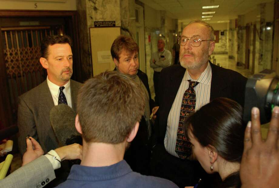 Mark Prothero (L) and Anthony Savage (R), lawyers for Gary Ridgway, speak with the media Dec. 18, 2003 in Seattle. Ridgway was sentenced to life in prison without the chance of release in King County Superior Court. Photo: Ron Wurzer, / / 2003 Getty Images