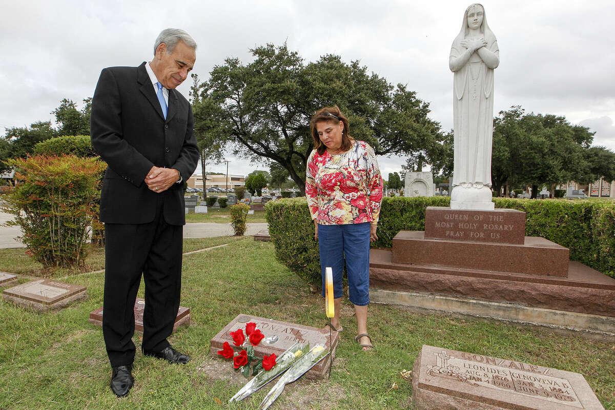 Former Congressman Charlie Gonzalez, left, and his sister, Genevieve Barto, visit the grave of their father, former Congressman Henry B. Gonzalez at San Fernando Cemetery No. 2 on Día de los Muertos last Wednesday.