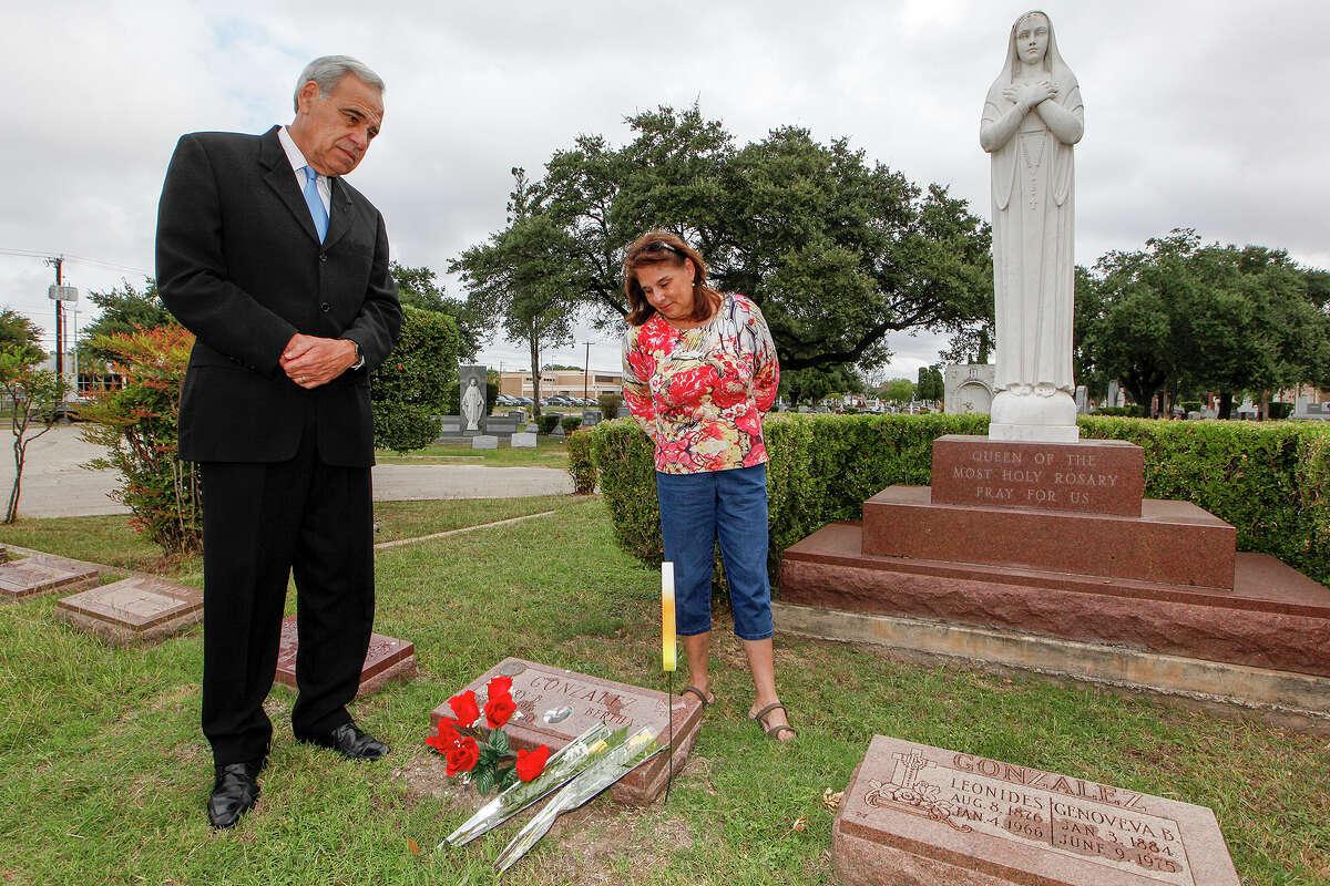 Former Congressman Charlie Gonzalez (left) and his sister, Genevieve Barto, visit the grave of their father, former Congressman Henry B. Gonzalez at San Fernando Cemetery No. 2 on Dia de los Muertos, Wednesday, Oct. 30, 2013. MARVIN PFEIFFER/ mpfeiffer@express-news.net