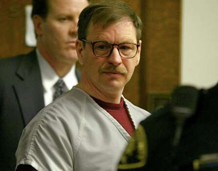 Gary Ridgway prepares to leave the courtroom where he was sentenced in King County Superior Court on Dec. 18, 2003 in Seattle, Washington. Ridgway received 48 life sentences, with out the possibility of parole, for killing 48 women over the past 20 years in the Green River Killer serial murder case. Photo: Pool, / / 2003 Getty Images