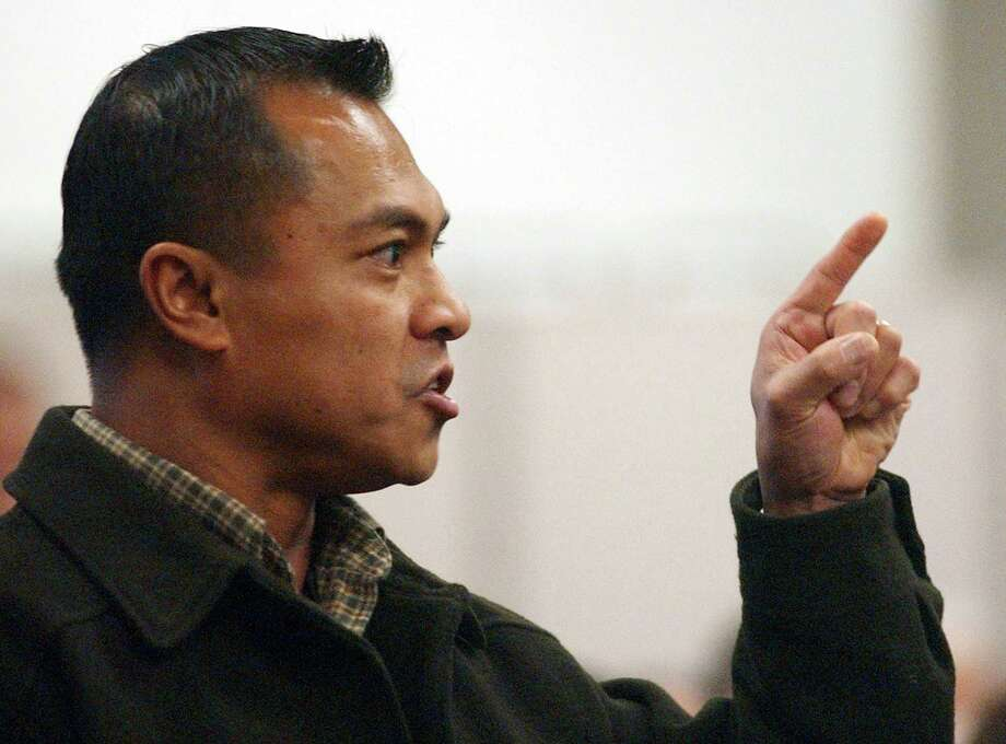 Jose Malvar Jr., brother of Green River Killer victim Marie Malvar, speaks at the sentencing of Gary Ridgway in King County Superior Court. Ridgway received 48 life sentences, without the possibility of parole, for killing 48 women over the past 20 years in the Green River Killer serial murder case. Photo: Pool, / / 2003 Getty Images