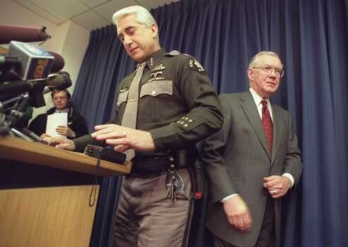 King County Sheriff Dave Reichart, left, takes the podium at a press conference given by King County Prosecutor Norm Maleng, right, after Maleng announced charges against Gary Ridgway. Ridgway was charged with four counts of aggravated murder in the Green River slayings. Photo: MERYL SCHENKER, P-I File Photos